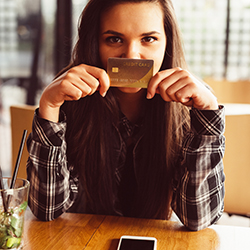 Girl at cafe with credit card