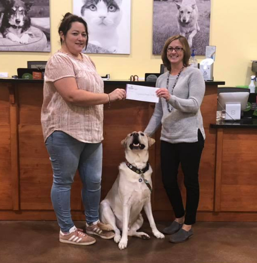CVFCU employee presenting check to Lynchburg Humane Society