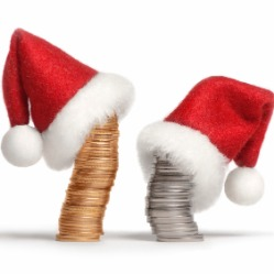 Stacks of coins with Santa hats