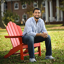 College age male on red chair at University of Lynchburg